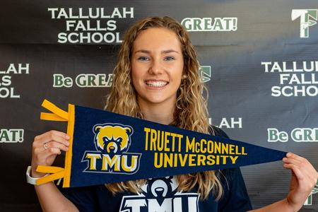 Senior Abby Carlan puts pen to paper with Truett McConnell